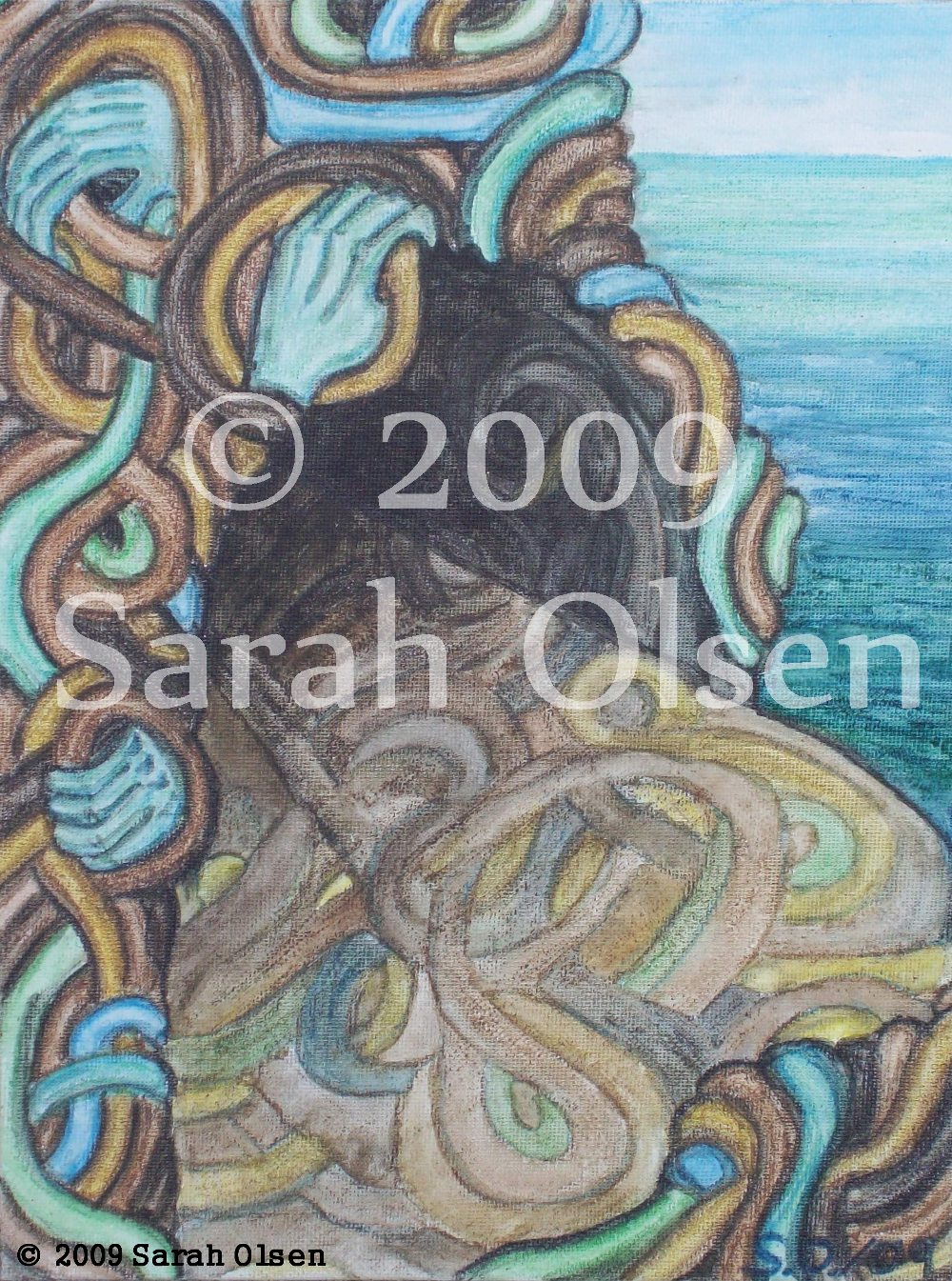 In this image a cave of woven bands and turquoise hands lies by the sea. The interwoven bands are earth and sea coloured.